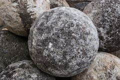 Stone balls on a stone pedestal. The cores are made for throwing a combat catapult. Close up royalty free stock image