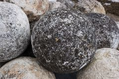 Stone balls on a stone pedestal. The cores are made for throwing a combat catapult. Close up stock photo