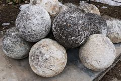 Stone balls on a stone pedestal. The cores are made for throwing a combat catapult. Close up stock photography