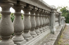 Stone balustrade. Beautiful stone balustrade in park Royalty Free Stock Images