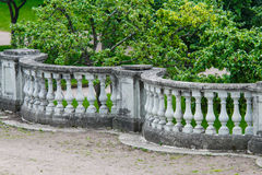 Stone balustrade fence. In front of the trees Royalty Free Stock Images