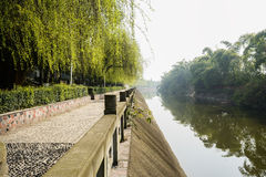 Stone balustrade fenced riverside pavement in sunny spring Royalty Free Stock Photos
