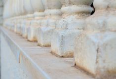 Stone balustrade. Old ancient white stone balustrade. element of the architecture of Spain Royalty Free Stock Photo