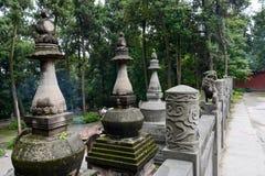 Stone balustrade before stupas Stock Photography