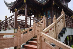Stone balustrades with bas-relief and sculptures of Chinese pavilion stock image