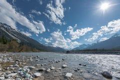 Stone bank at flowing river lech in tirol Royalty Free Stock Photos