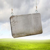 Stone banner hanging on ropes Stock Images