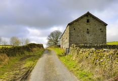 Stone barn in countryside Stock Photography