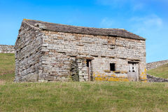 Stone Barn in Meadowland. A traditional stone barn in a field in the Yorkshire Dales, England Royalty Free Stock Images