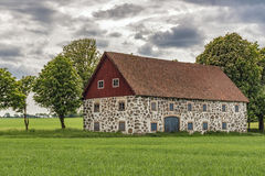 Stone barn. An old stone barn with wooden roof set in the rural countryside of Swedens Skane region Stock Images