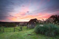 Stone barn at sunrise Royalty Free Stock Images