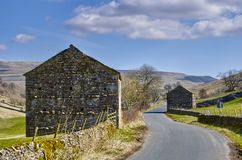 Stone barns in countryside Stock Photos