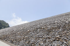 Stone barrier,. Dam on blue sky royalty free stock photos
