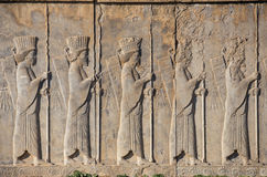 Stone bas-relief in ancient city Persepolis, Iran. Royalty Free Stock Images