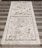 Stone bas-relief at the entrance to the temple Stock Image