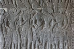 Stone bas-relief with human figures in Angkor Wat temple, Siem Reap, Cambodia. Male figure stone carving on ancient wall. Stone bas-relief with human figures in Stock Photos