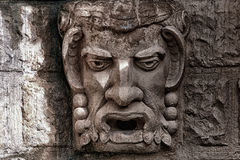 Stone bas-relief a kind of a head of a demon Stock Images