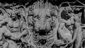 Stone bas-relief of lion and gods.  Stock Photo