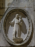 Stone bas relief saint child Stock Image