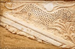 Stone bas-relief sculpture detail on the ancient wall royalty free stock photo
