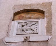 Stone bas-relief of the Venetian lion on one of the houses of Canegliano. The lion of St. Mark is a symbol of the city Stock Photography