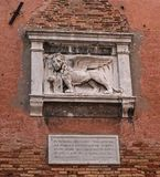 Stone bas-relief of the Venetian lion on the wall of the Arsenal of Venice. The lion of St. Mark is a symbol of the city stock photos