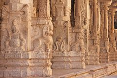 Stone bas-reliefs on the column in Shiva Virupaksha Temple, Hampi. Carving stone ancient background. Carved figures made of stone. Unesco World Heritage Site royalty free stock images