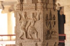 Stone bas-reliefs on the column in Shiva Virupaksha Temple, Hampi. Carving stone ancient background. Carved figures made of stone. Unesco World Heritage Site stock photo