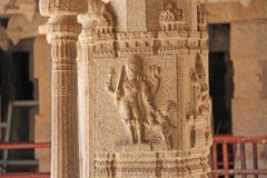 Stone bas-reliefs on the column in Shiva Virupaksha Temple, Hampi. Carving stone ancient background. Carved figures made of stone. Unesco World Heritage Site royalty free stock photos