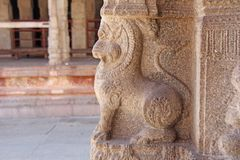 Stone bas-reliefs on the column in Shiva Virupaksha Temple, Hampi. Carving stone ancient background. Carved figures made of stone. Unesco World Heritage Site stock photos