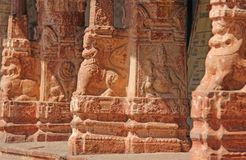 Stone bas-reliefs on the column in Shiva Virupaksha Temple, Hampi. Carving stone ancient background. Carved figures made of stone. Unesco World Heritage Site stock image