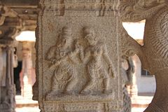 Stone bas-reliefs on the column in Shiva Virupaksha Temple, Hampi. Carving stone ancient background. Carved figures made of stone. Unesco World Heritage Site royalty free stock photography