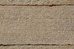 Stone bas-reliefs on the walls around the Vittala Temple in Hampi, Karnataka, India. Unesco World Heritage Site. The famous tourist destination from GOA Stock Photography