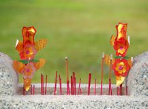 Stone Basin with Incense Sticks Royalty Free Stock Images