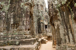 Stone Bayon Temple, Cambodia. Facade of stone Bayon Temple in Cambodia on sunny day Royalty Free Stock Photography