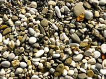 Stone beach. All kinds of stones on the beach in Nerja, Spain stock image