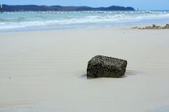 Stone on the beach. Stone beach sand Solitary Strong rapids Royalty Free Stock Images