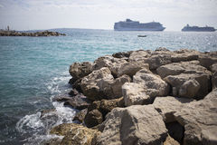 Stone beach on the background of cruise liners Stock Photography