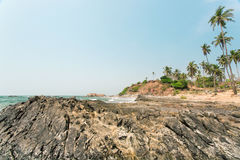 Stone beach and calm waters of Indian ocean, Goa state, India Royalty Free Stock Photography