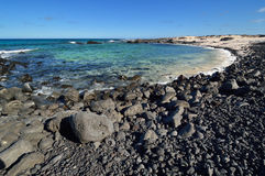 Stone beach on Canary Islands, Lanzarote. Spain. Caleta del Mojon Blanco Stock Photo