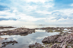 Stone on the beach and clound on the sky blue morning time. Asia seascapes Stock Photos