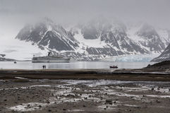 A stone beach in Magdalena bay, Spitzbergen. On a misty, overcast day Royalty Free Stock Image