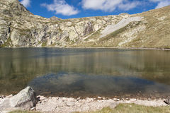 Stone on the beach -  mountain lake Stock Photography