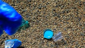 Stone beach plastic bottle package garbage hd footage
