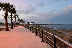 Stone beach promenade at sunset Royalty Free Stock Photos