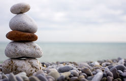 Stone and beach of the sea. Cairn of stone at the beach of the sea Stock Photography