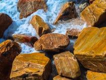 Stone beach Stock Images