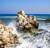 Stone on the beach. A stone in the sea, where the waves break on the beach near the rock of Aphrodite./Stone on the beach./ Petra tou Romiu.Cyprus Royalty Free Stock Photos
