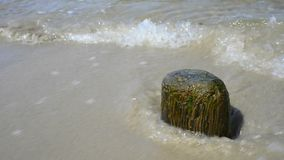 Stone at a beach with soft break-wave at the Baltic sea Royalty Free Stock Photography