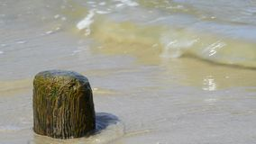 Stone at a beach with soft break-wave at the Baltic sea Stock Image